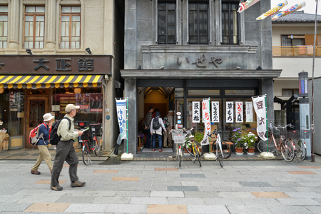 Kawagoe, Japan - May 14, 2017: Many tourists and local people are walking along shops and stores, which used to be the old warehouse, in Kawagoe, Japan.