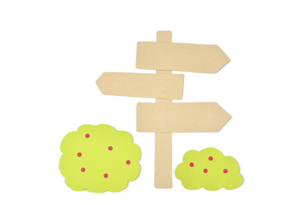 Blank wooden direction signpost and bush paper cut on white background - isolated