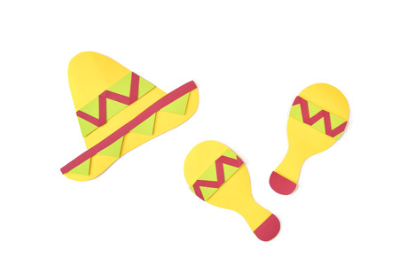 Mexican hat and maracas shaker paper cut on white background - isolated