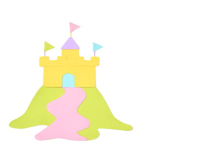 Castle on the hill paper cut on white background - isolated