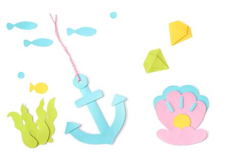 Sea treasure element paper cut on white background - isolated Stock Photo