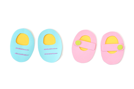 Baby shoes paper cut on white background - isolated