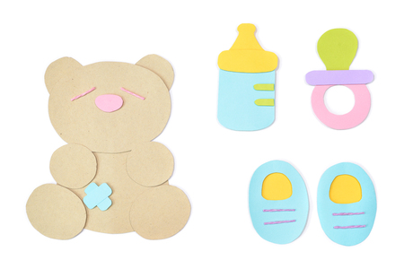 Baby accessories paper cut on white background - isolated Stock Photo