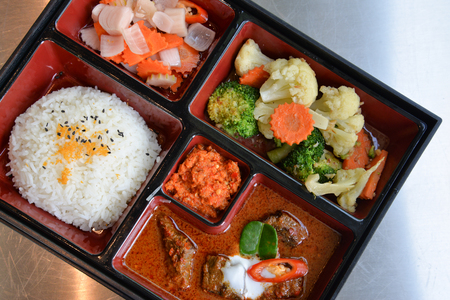 Rice with beef curry in bento - creative dish