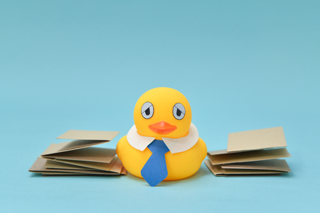 Office life concept, rubber duck has got a lot of work.