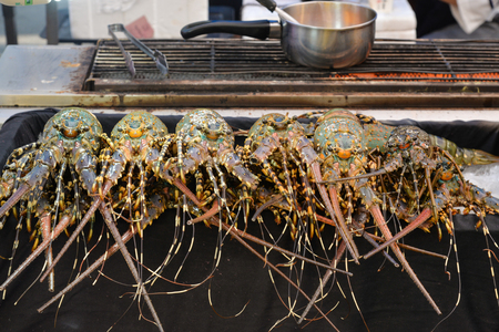 Rainbow lobster for barbecue at Phuket weekend market, Thailand Stock Photo