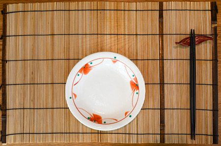 Placemat with plate and chopsticks (Japanese style)