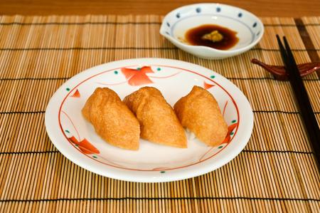 Inari sushi, deep fried tofu filled with rice (Japanese food)
