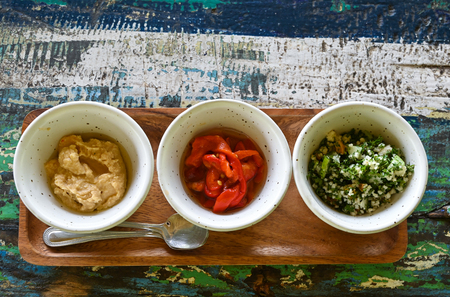 Variety of dips on old wooden table