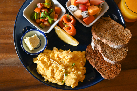 Big breakfast with eggs, fruit and bread Stock Photo