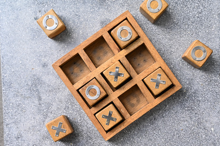 Wooden tic tac toe (O X) game. The concept of business strategy and competition