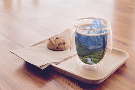 Mountain in a coffee cup (Dream of vacation concept) Foto de archivo