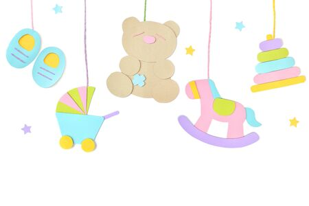 Baby toys hanging paper cut on white background - isolated