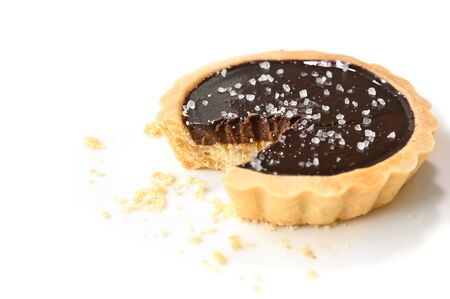 Salted chocolate tart on white background - isolated