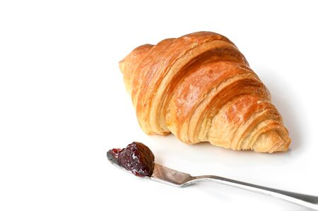 Croissant with jam on white background - isolated