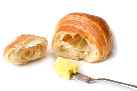Croissant with butter on white background - isolated