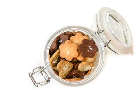 Homemade small cookies in a glass jar on white background - isolated 写真素材