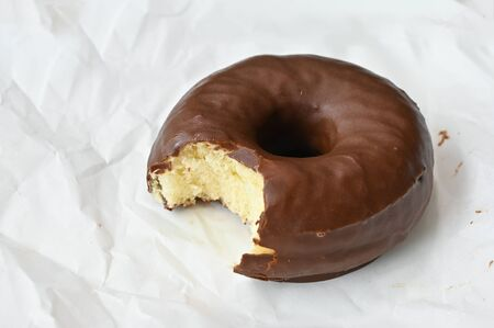 Chocolate donut on white wrinkle paper
