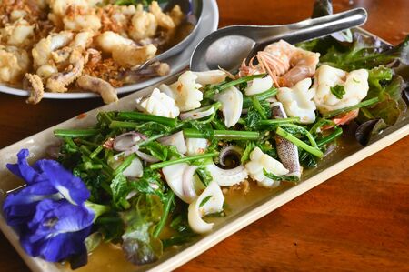 Spicy salad with local vegetables(Phak Kood) and seafood  Phuket, Thailand 写真素材