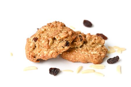 Homemade oatmeal almond raisin cookies on white background - isolated 写真素材