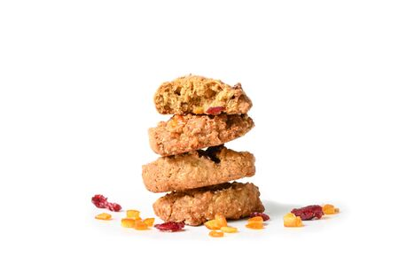 Homemade oatmeal orange cranberry cookies on white background - isolated