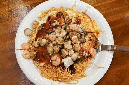 Okonomiyaki, Japanese food, on white plate
