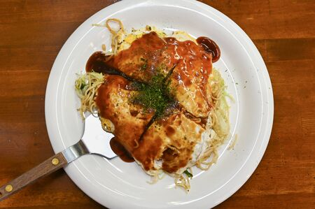 Okonomiyaki, Japanese food, on white plate