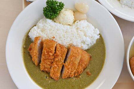 Japanese pork cutlet with green curry and rice (Tonkatsu)