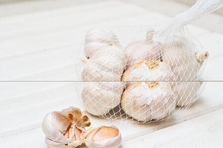 Clove of garlic on wooden counter Stock Photo