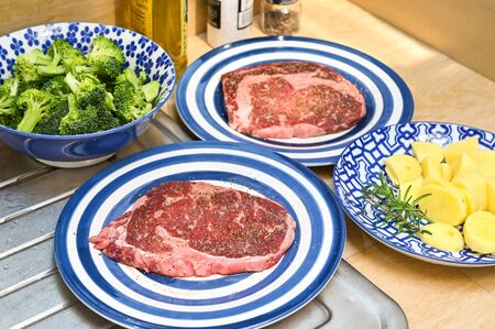 Cooking steak and vegetables at home Stock Photo