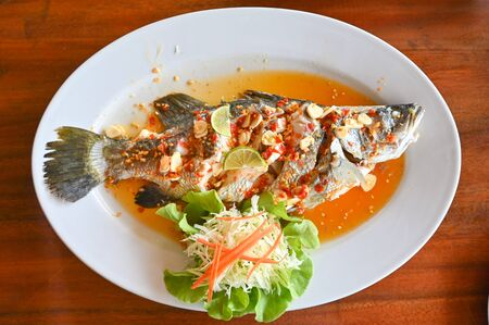 Steamed fish with lime - Thai food Stock Photo