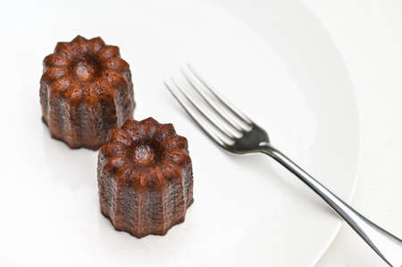 Canele, French pastry, on white plate 写真素材