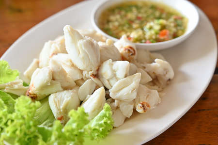 Steamed crab meat with sour and spicy sauce - Thai food