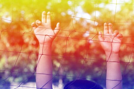 mesh fence: Hands with rope mesh fence