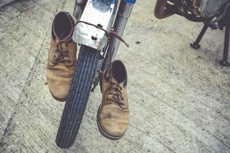 dirty feet: Mens leather shoes and old Motorcycles.,Vintage concept