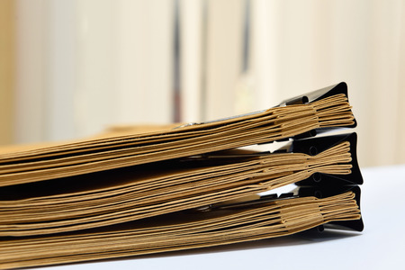 stack of documents: a file folder with documents and important document