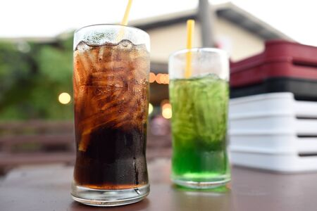 carbonation: drink: glass of cold cola on wood
