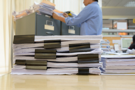 document management: a file folder with documents and important document,Business Concept