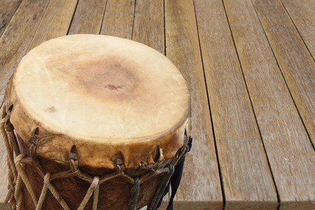 djembe drum: drum,Drum production in drums made of cowhide leatheron wood background Stock Photo