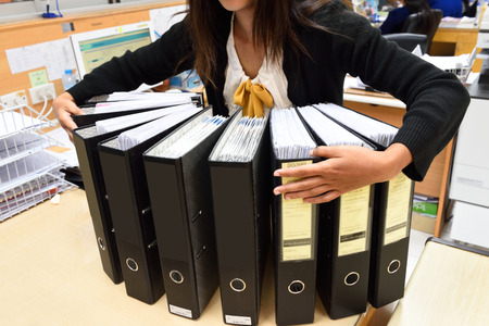 A woman in the office document management Stock Photo