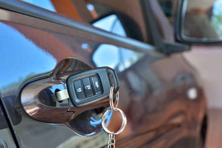 car door: Car key is inserted in a slot car keys. Stock Photo