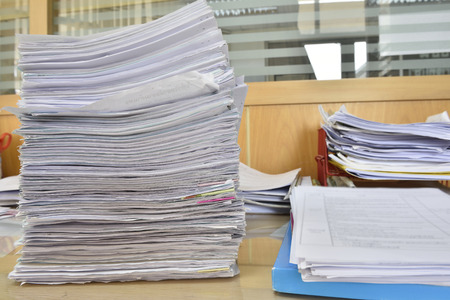 indexed: documents on desk in office Stock Photo