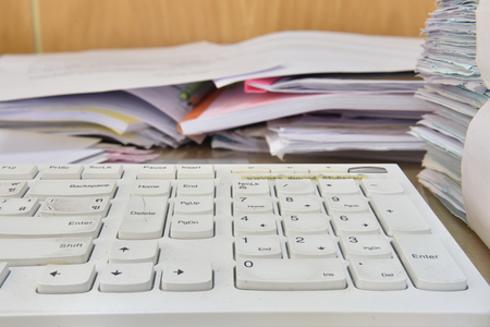 indexed: keyboard and documents on desk in office