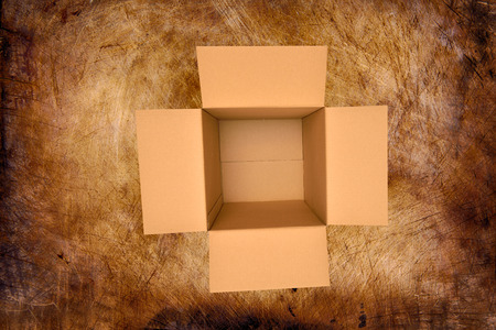 shipped: Brown box on old wood background Stock Photo