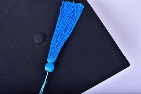 cap and gown: Cap, gown graduates on isolated background