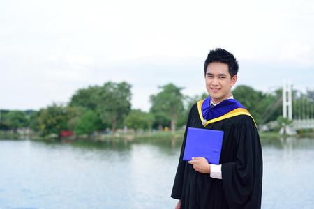 graduated: Happy graduated student guy at graduation ceremony Stock Photo