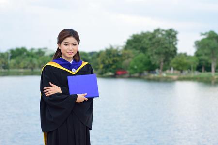 graduated: Happy graduated student girl at graduation ceremony