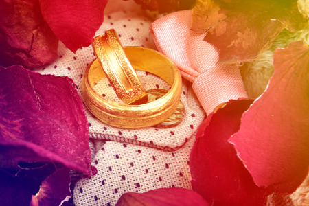 rose ring: wedding ring on Dried rose petals background