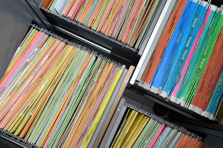top view colorful hanging file folders in drawer,For filing and searching for documents. Stock Photo
