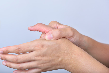 Woman fingers ache in isolated background